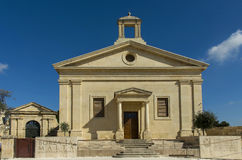 Malta, Streets of Valletta. Building of the Malta Stock Exchange, former garrison church built in 1857 - Valletta, Malta Royalty Free Stock Image
