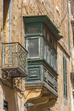 Malta, Streets of Valletta. Small balconies on an old building in the Maltese capital city, Valletta, Malta Royalty Free Stock Image