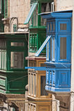 Malta, Streets of Valletta. Small wooden closed balconies on houses along the street in the Maltese capital city, Valletta, Malta Stock Photography