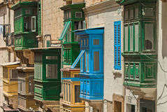 Malta, Streets of Valletta. Small wooden closed balconies on houses along the street in the Maltese capital city, Valletta, Malta Royalty Free Stock Photo