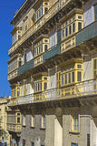 Malta, Streets of Valletta. Small wooden closed balconies on houses along the street in the Maltese capital city, Valletta, Malta Stock Photos
