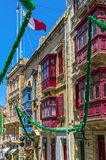 Malta - Streets of Vittoriosa. Old buildings in the historic part of the Città Vittoriosa, main city of Malta from 1530 to 1571, at fiesta time - Vittoriosa or Royalty Free Stock Photo