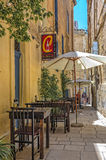 Malta - Streets of Vittoriosa. One of the charming cafes in the historic part of the Città Vittoriosa, main city of Malta from 1530 to 1571 - Vittoriosa or Royalty Free Stock Photography
