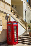 Malta - Streets of Cospicua. Red British-style phone booth - The Three Cities, Cospicua or Bormla, Malta Stock Photo