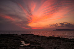 Malta Sunset. A dramatic Maltese dancing sunset looking towards Gozo Royalty Free Stock Photos
