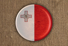 Malta Textured Round Flag wood on rough cloth. High Resolution Stock Image