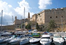 Malta, Three Cities, Medieval fort and marine in L-Isla, Valletta. Scenic landscape of Medieval fort and marine in L-Isla, one of the Three Cities, located Royalty Free Stock Photo