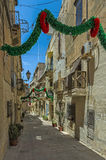 Malta - Three Cities. Narrow street and buildings in the oldest part of the historic Città Vittoriosa, main city of Malta from 1530 to 1571 - Vittoriosa or Royalty Free Stock Image