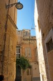 Malta, Three Cities, Scenic Medieval street in L-Isla, Valletta. Scenic, narrow Medieval street and buildings in L-Isla, one of the Three Cities, located Royalty Free Stock Photography