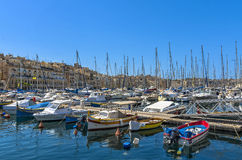 Malta - Three Cities. Vittoriosa yacht marina and architecture of Cospicua in the background - Malta Royalty Free Stock Photo