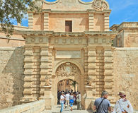 Malta. Tourists. Valetta, Malta - SEPTEMBER 11, 2013: Tourists visiting the ancient temples of Malta. Malta is a favoured tourist destination with its warm Royalty Free Stock Photo