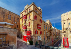 Malta. Traditional balconies on the houses. Traditional multi-colored wooden balconies on the houses. Valletta. Malta Royalty Free Stock Photo