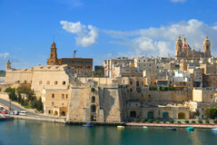 Malta, Valetta harbor, The Three Cities; Cospicua. Malta, Valetta harbor, The Three Cities; a view to Cospicua waterfront from high up in Vittoriosa on a sunny Stock Photography