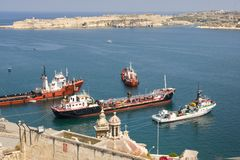 Malta Valetta harbour with ships. Malta La Valetta view of the harbour with a cruiser and a freighter Stock Image