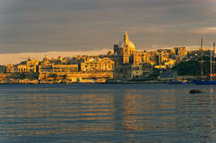 Malta, Valletta. Evening Valletta, houses and St. Paul's Angclican Cathedral and Carmelite Church Stock Photography
