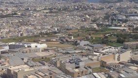 Malta Valletta city aerial view. Landing airplane passenger window porthole aerial view of Mediterranean island country Malta capital city Valletta, establishing stock footage