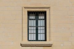 Malta, Valletta. Facade of yellow limestone house with closed window with metal bars, that provides safety. Close up view. Malta, Valletta. Facade of yellow Royalty Free Stock Photos