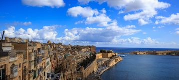 Malta, Valletta. Grand harbor in mediterranean. Blue sea and blue sky with few clouds background. Panoramic view, banner. Royalty Free Stock Photography