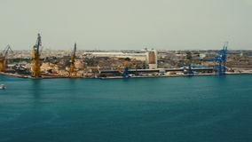 Malta, Valletta - July 1st, 2016:View from Upper Baraka Gardens on war museum on Senglea,Birgu and Kalkara. VALLETTA, MALTA - July 1st 2016: view over the bay stock video footage