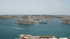 Malta, Valletta - July 1st, 2016:View from Upper Baraka Gardens on war museum on Senglea,Birgu and Kalkara. VALLETTA, MALTA - July 1st 2016: view over the bay stock footage