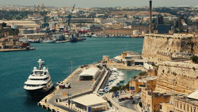 Malta, Valletta - July 1st, 2016:View from Upper Baraka Gardens on war museum on Senglea,Birgu and Kalkara. VALLETTA, MALTA - July 1st 2016: view over the bay stock video