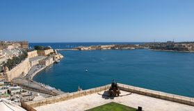Malta, Valletta, Scenic landscape of forts with gun and the bay. Unique and the most beautiful landscape of the Stock Photos