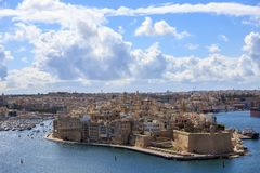 Malta, Valletta. Senglea, a fortified grand harbor under a blue sky with few clouds. Panoramic view, town background. Royalty Free Stock Photos