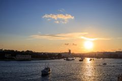 Malta, Valletta. Sliema town, sea and sky at sunset, sunrise background. Panoramic view. Malta, Valletta. Sliema town, sea and sky with few clouds at sunrise Stock Photos