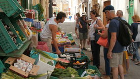 Malta, Valletta, 3th of July 2016. Retail fresh fruit and vegetables in a small street. A lot of different people prefer. Goods stock video