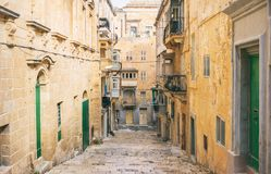 Malta, Valletta. Traditional narrow street with stairs in the city center. Malta, Valletta. Traditional narrow street with stairs in the historical city center Stock Photography