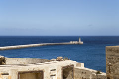 Malta Valletta fortress and lighthouse. View on a lighthouse over the walls of an ancient fortress in Valletta on Malta Royalty Free Stock Image