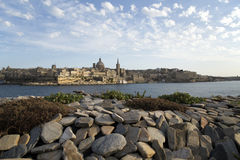 Fortress of Valletta on Malta. View over some pebbles on the skyline of the old town of Valletta, Malta Stock Photo
