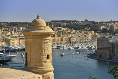 Malta Valletta watchtower. Watchtower and fort St. Angelo in Grand Harbour of Valletta, Malta Royalty Free Stock Photo