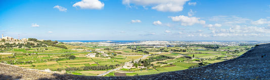 Malta - view from mdina down to valletta. Impressive panorama view from mdina down to the sea and valletta at the horizon Royalty Free Stock Photos