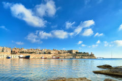 Malta, view on Valletta with its traditional architecture. From Vittoriosa peninsula on a bright day Stock Photography