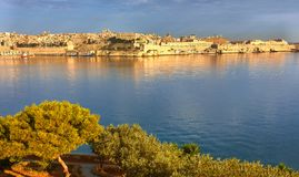 Malta, view on Valletta from Kalkara peninsula early in the morn. Malta, view on Valletta with its traditional architecture from Kalkara peninsula early in the Royalty Free Stock Photography