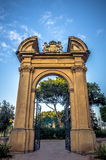 Malta, Views of Floriana. Entrance gate with a stone arch and the British monarchy coat of arms at the top - King George V Gardens, Floriana, Malta Stock Photography