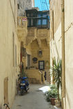 Malta - Gozo, Victoria. Charming narrow street alley in the capital of Gozo, Victoria, Rabat, Malta Royalty Free Stock Image