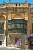 Malta - Gozo, Victoria. Old building with a typical small wooden closed balcony in the capital of Gozo, Victoria, Rabat, Malta Stock Image