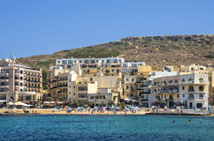 Malta - Gozo, Marsalforn. View of the old fishing village of Marsalforn, an important tourist resort, lined with hotels and apartment buildings Stock Image