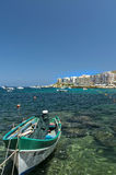 Malta - Gozo, Marsalforn. View of the old fishing village of Marsalforn, an important tourist resort, lined with hotels and apartment buildings Royalty Free Stock Photo