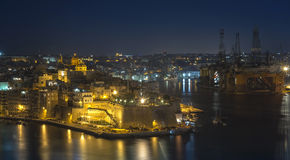 Malta - Panorama of Three Cities. Impressive night view of the Three Cities across Grand Harbour from Valletta Stock Images
