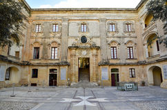 Malta Vilhena palace courtyard. Courtyard of the vilhena palace with tile stone maltese cross, mdina, malta.  The Palazzo de Vilhena was built in the early 1700s Royalty Free Stock Photos