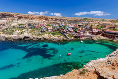 Malta. Village Popeye. View of the famous village Popeye and bay on a sunny day. Malta Stock Photo