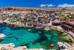 Malta. Village Popeye. View of the famous village Popeye and bay on a sunny day. Malta Stock Image