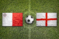 Malta vs. England flags on soccer field Royalty Free Stock Photo