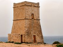 Malta watch tower. Maltese watch tower, built during the reign of the Knights of the Order of St John, is watching over the Mediterranean Sea Royalty Free Stock Photos