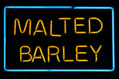 Malted Barley Sign. Bright yellow & blue Malted Barley Neon Sign Stock Image