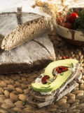 Malted bread slice with avocado. + rustic background Stock Photography