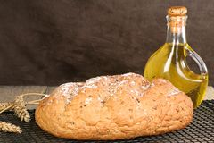 Malted grain bread. Home baked malted barley bread on a cooling rack Royalty Free Stock Photo